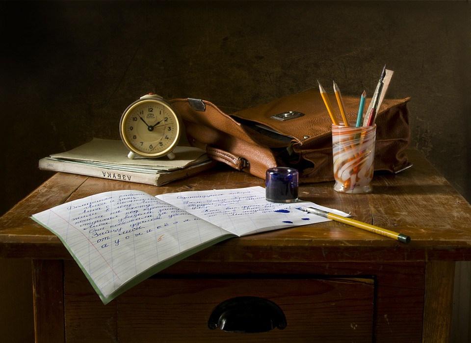 open written notebook on desk