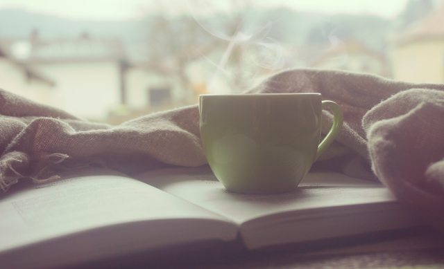 steaming mug and book