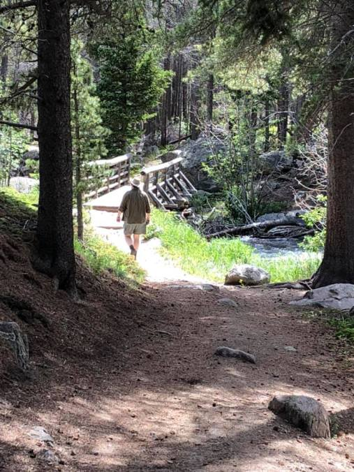 Troy walking ahead on trail day 2 hiking July 2019