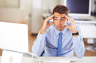 frustrated dude looking at computer