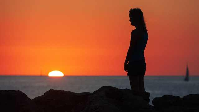 woman in sunset sad