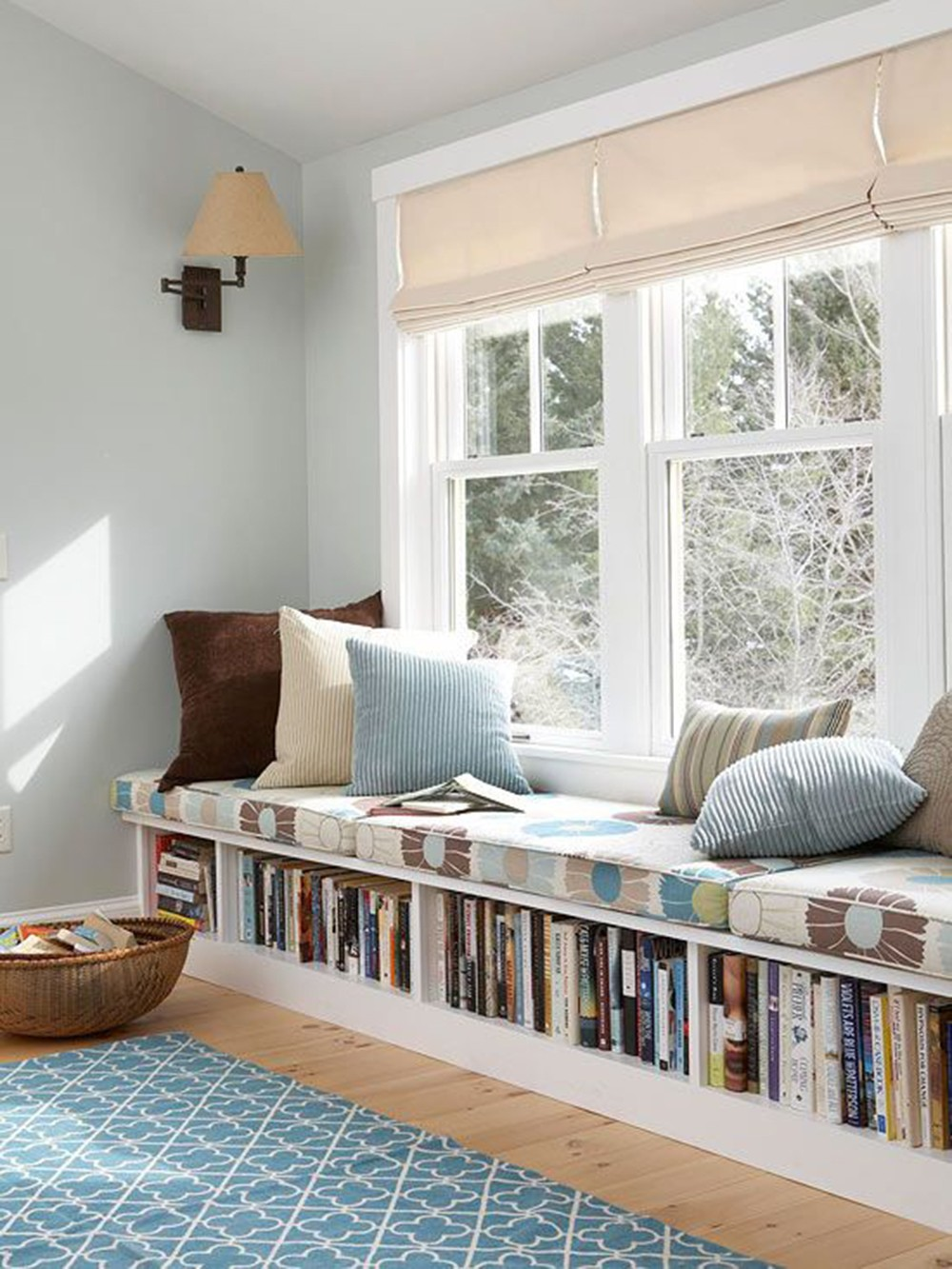 window seat with books and pillows