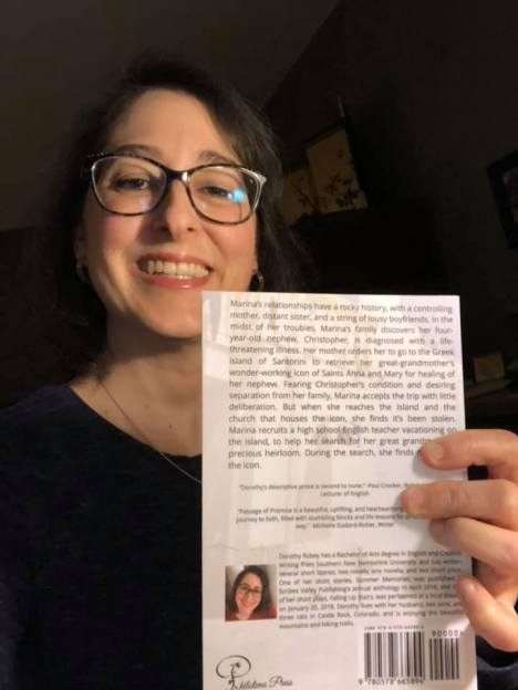 Me showing the back of my book PofP April 1 2020